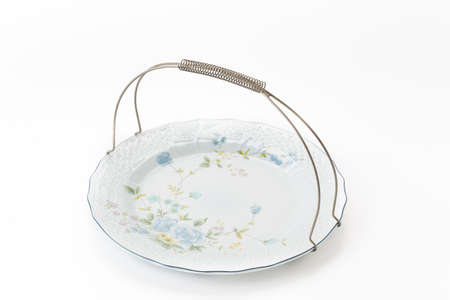 antique dishes: old plate on white background