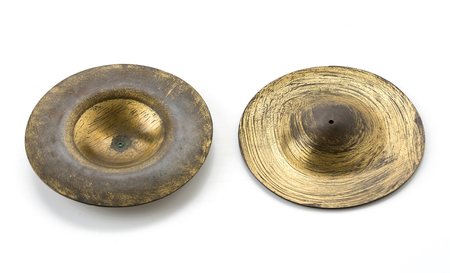 cymbals: old cymbals on white background