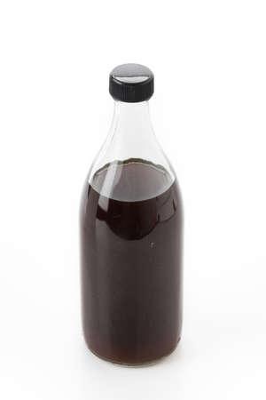 antacid: ginger stomachic liquid bottle on white background