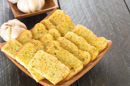 garlic: crispy bread garlic on wood background