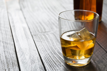 liquor glass: wisky glass  on wood table