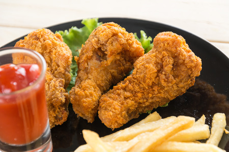 chicken leg: fried crispy chicken on wood Stock Photo