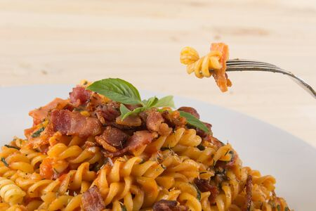 penne: penne pasta on wood background