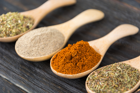dry leaf: Spices and herbs in bowls. Food and cuisine ingredients.