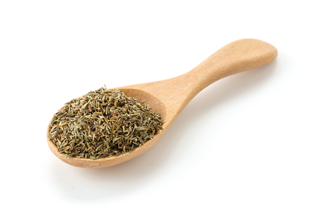 thyme: dry thyme on wood spoon Stock Photo