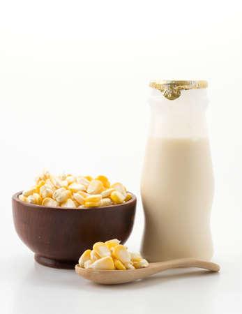 yellow corn: corn milk on white background