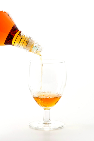 pouring wisky on white background Banque d'images