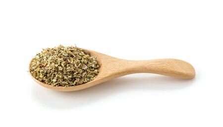 oregano: oregano on wood spoon on white