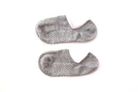 dirty feet: grey sock on white background Stock Photo