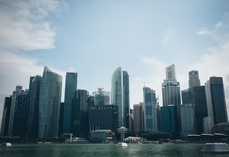 singapore: SINGAPORE, SINGAPORE - JULY 16 2015: View of downtown Singapore city. Singapore is one of the worlds major commercial hubs.- with film filter effect