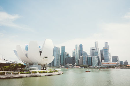 museums: SINGAPORE - July 16, 2015: ArtScience Museum is one of the attractions at Marina Bay Sands, an integrated resort in Singapore.- with film filter effect Editorial
