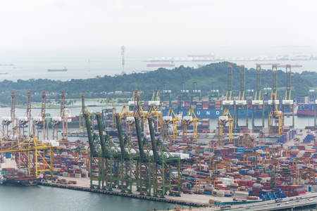 sea port: Landscape from bird view of Cargo ships entering one of the busiest ports in the world, Singapore.