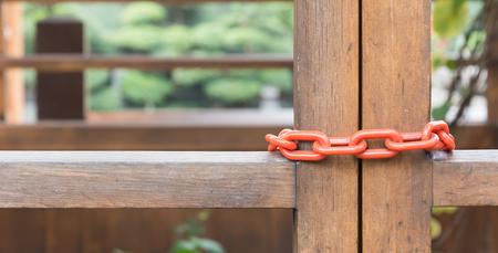 locked: chain locked on wood door Stock Photo
