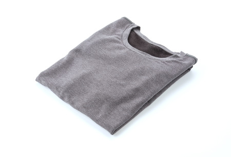 fold: shirt. folded t-shirt on white background Stock Photo