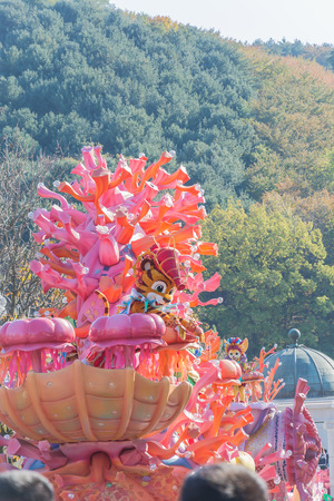 october 31: SOUTH KOREA - October 31: Dancers in colorful costumes take part in a street parade in Everland Resort, Yongin City, South Korea, on October 31, 2015