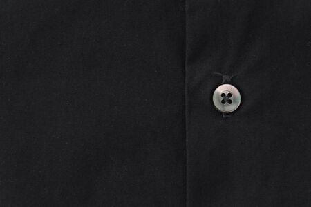 black button: Close up of a button on shirt