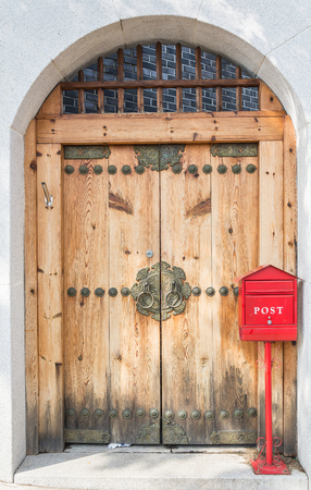 red post box: red post box with wood door Stock Photo