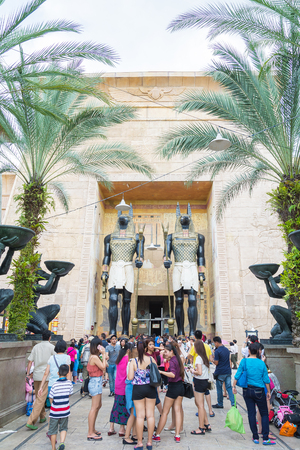 archaeologist: SINGAPORE - July 20 2015: Visitors walking at the Ancient Egypt in Singapore. Ancient Egypt it is part of themed zone at the Universal Studios Singapore theme park.
