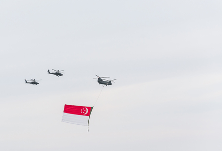 air force: Singapore July, 18 2015:  helicopter fly on sky for Fiftieth anniversary of Singapore 50 years National Day Golden Jubilee