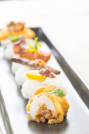 fusion: omelet with spicy pork sushi - fusion food