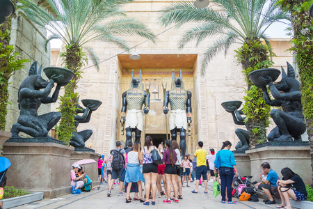 walking zone: SINGAPORE - July 20 2015: Visitors walking at the Ancient Egypt in Singapore. Ancient Egypt it is part of themed zone at the Universal Studios Singapore theme park.