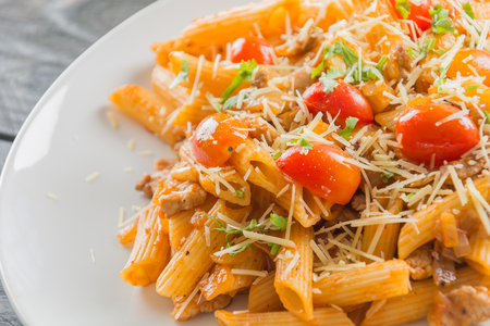 penne: Penne pasta in tomato sauce Stock Photo