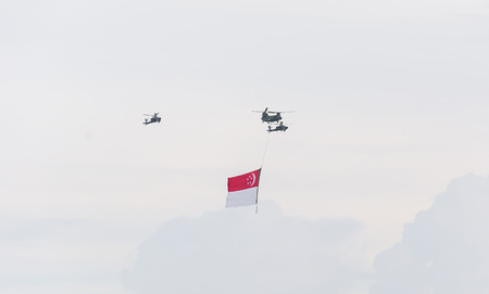 jubilee: Singapore July, 18 2015:  helicopter fly on sky for Fiftieth anniversary of Singapore 50 years National Day Golden Jubilee