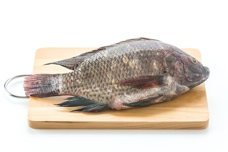 white nile: Black Tilapia or Tilapia on wood board