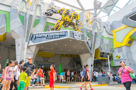 space wars: SINGAPORE - JULY 20,2015 : TRANSFORMERS The Ride: The Ultimate 3D Battle The statue of Autobot robot at Sci-Fi City, Universal Studio, Singapore