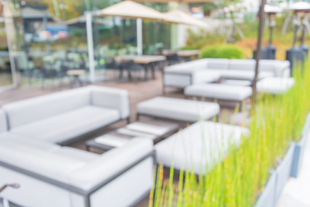 patio deck: Abstract Blur Table and chair with  umbrella outdoor patio
