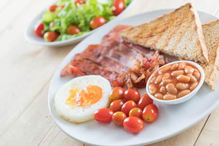 bacon baked beans: breakfast on wood table