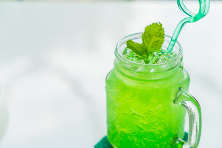 green apple: green apple soda on white table