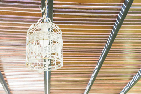 birdcage: Birdcage lamps hanging on wooden ceiling