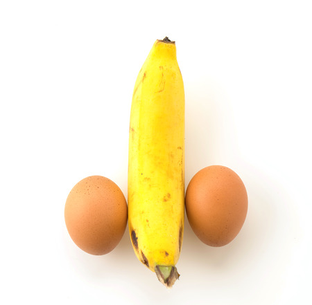 phallic: eggs and banana composing on white background