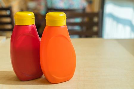 sauce bottle: sauce bottle on table in restaurant