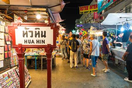 hua hin: HUA HIN, THAILAND - Jan 22 2016: Tourists stroll at the night market in Hua Hin. The famous night market in Hua Hin is a major tourist attraction.
