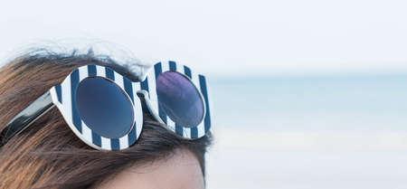 Close up sun glasses on head