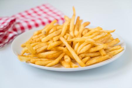 comida chatarra: Patatas fritas de oro patatas Foto de archivo