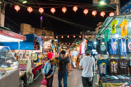 stroll: HUA HIN, THAILAND - Jan 22 2016: Tourists stroll at the night market in Hua Hin. The famous night market in Hua Hin is a major tourist attraction.