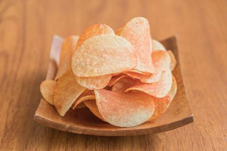 nosh: potato chips on a plate