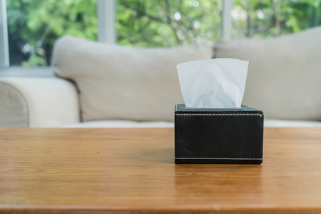 snot: tissue boxes on wood table