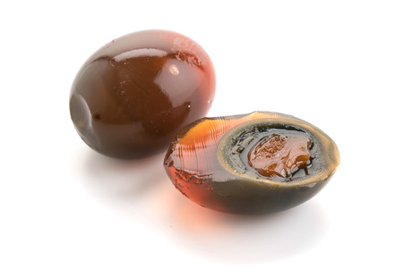 preserved eggs on white background