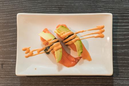 tuna mayo: salmon avocado nigiri - japanese food