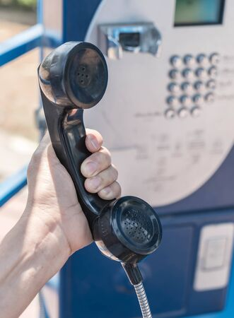 insertion: Public phone made from metal with keypad, coin insertion