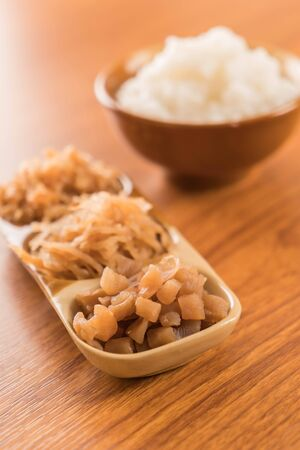 chinese meal: Boiled rice or mush with Pickled radish Stock Photo