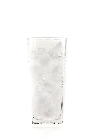carbonated: Glass of mineral carbonated water with ice on white background