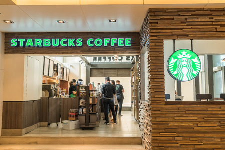 shopfront: BANGKOK, THAILAND - MARCH 30, 2016: Starbucks Coffeehouse shop. Starbucks is the largest coffeehouse company in the world, with 21,536 stores in 64 countries and territories. Editorial