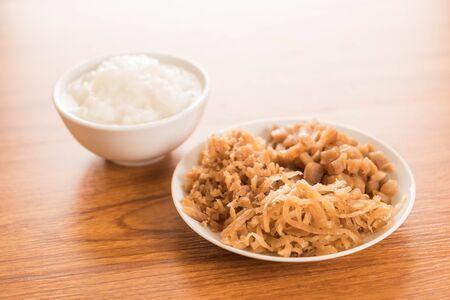 mush: Boiled rice or mush with Pickled radish Stock Photo