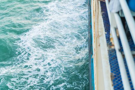 lurk: Ocean Wave Crashing a Ship Stock Photo