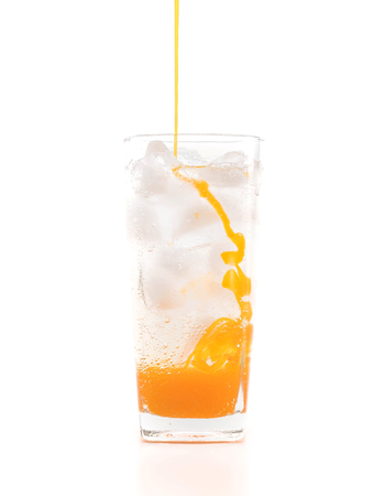 carbonated: fresh, ice cold carbonated water in glass on white background